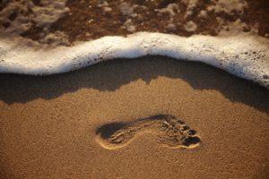 orma sulla sabbia